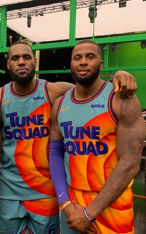 """Former Bradley University forward Zach Andrews, right, on the set of the movie """"Space Jam: A New Legacy"""" with LeBron James."""
