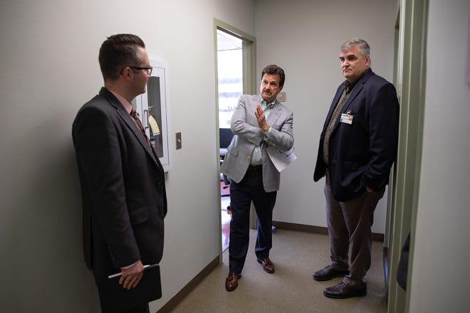 Texas Tech President Schovanec talks with Cam Brown and Doug Smith.