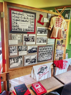 Shown are historical photos from Lansing High School on display at the Lansing Historical Society and Museum.