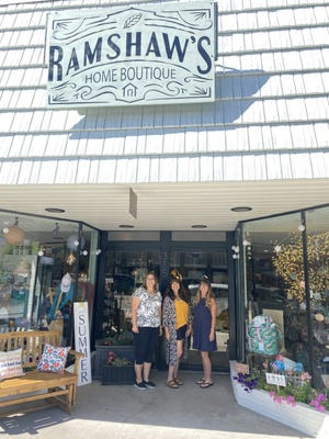 Ramshaw's Home Boutique owner Dawne Ramshaw, center, stands with gift manager Kelly Dickinson (left) and promotions manager Brenda Spring in front of the newly opened business on North Mt. Shasta Boulevard, which carries home decor, gifts and other special treasures, on July 20, 2021.