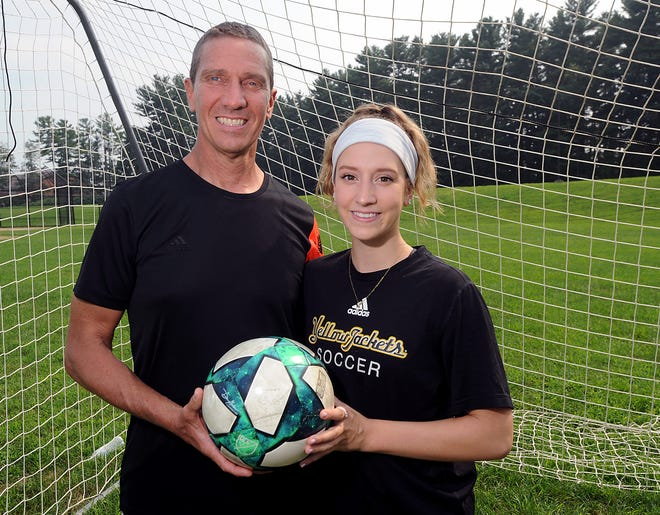 Blackstone Valley Technical High School girls soccer coach John Porter, and daughter Caroline, who played for him at BVT and now plays at American International College, July 20, 2021.