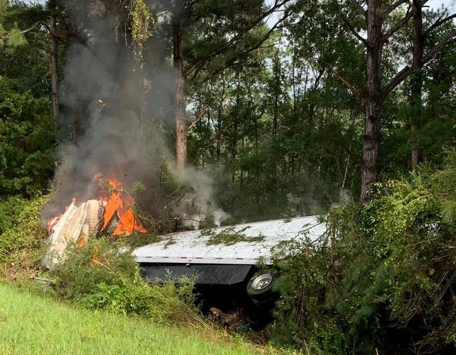 A semitrailer struck several trees and caught on fire on the south shoulder of Interstate 10 east of Crestview on Monday. The 24-year-old driver from New York was flown to an area hospital after suffering critical injuries.