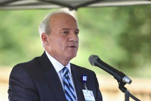Fort Walton Beach Medical Center CEO Mitch Mongell speaks during the opening of a new medical clinic at One Hopeful Place in Fort Walton Beach in 2019.