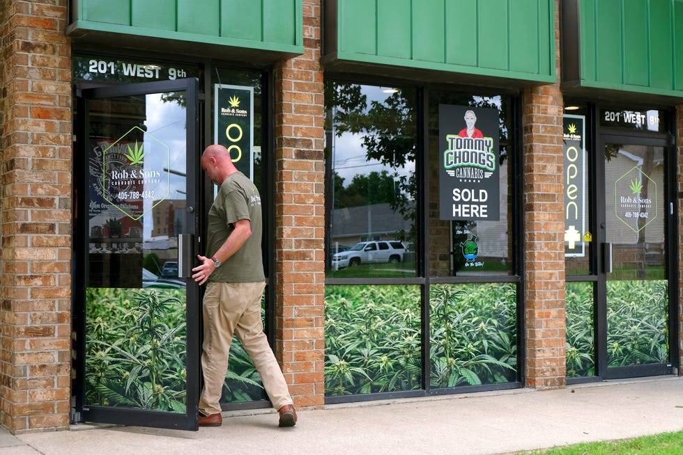 Owner Rob Speight enter his store, Rob & Sons Cannabis Company in Shawnee, Okla., Tuesday, July 20, 2021.