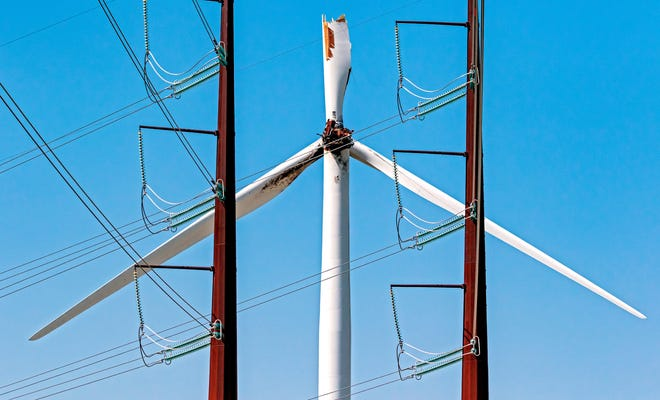 A damaged wind tower stands at the KODE Novus I and II facility southeast of Guymon in Oklahoma's Panhandle.