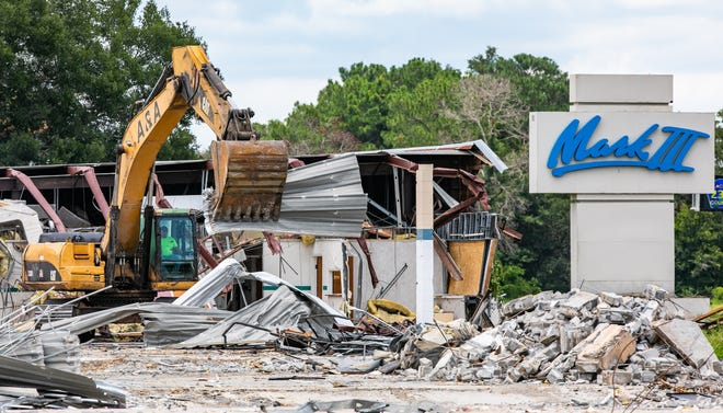 A&A Demolition and Excavation was busy tearing down the old Mark III buildings on Tuesday. Green Thumb Industries and a developing partner will redevelop part of the facility to serve as a medical marijuana operation. [Doug Engle/Ocala Star Banner]2021