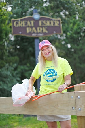 Heidi Anderson, of Weymouth, has been picking up litter at local parks, such as Great Esker, since moving to town four years ago.