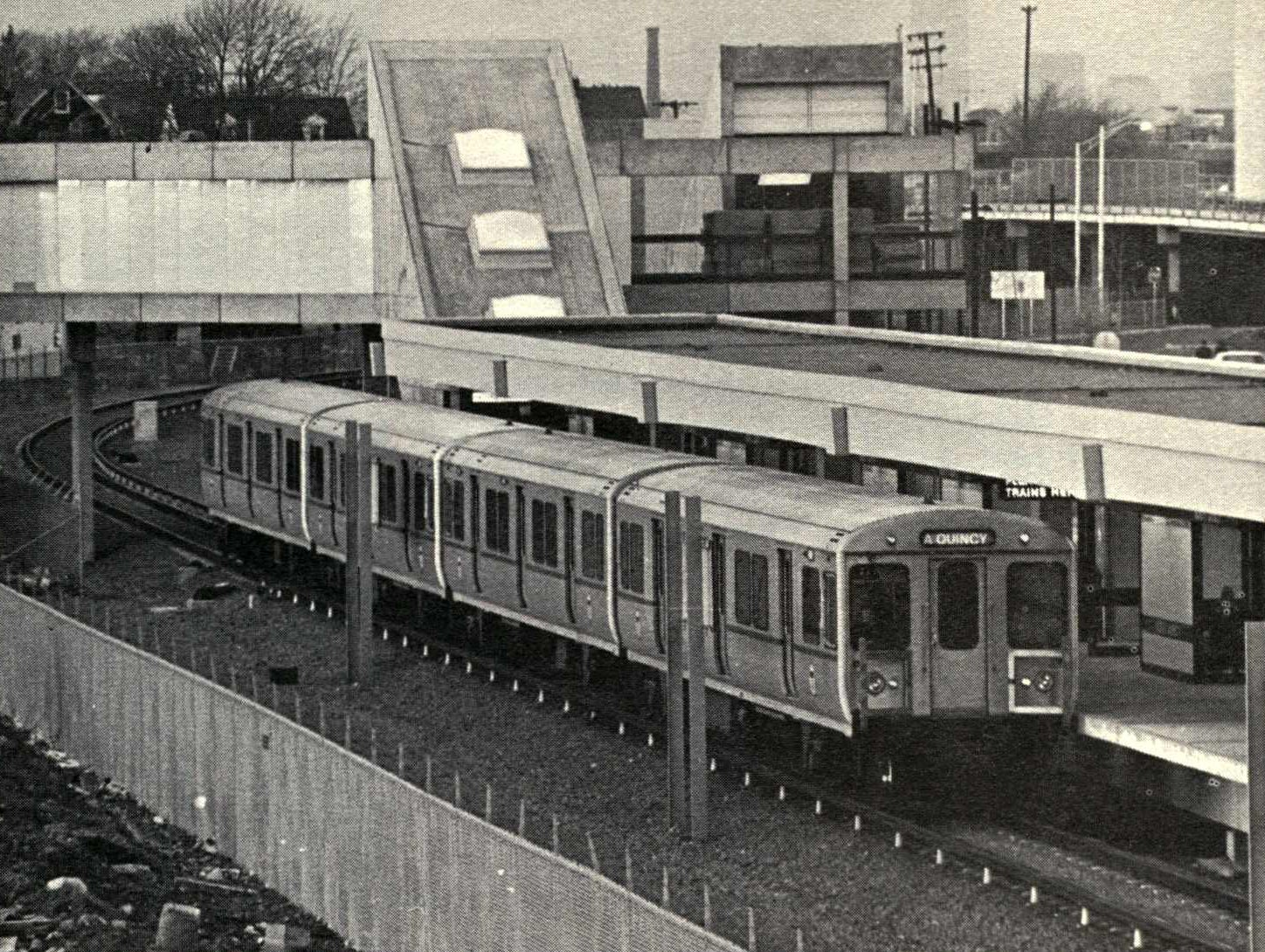 A Red Line train arrives at North Quincy Station circa 1971.