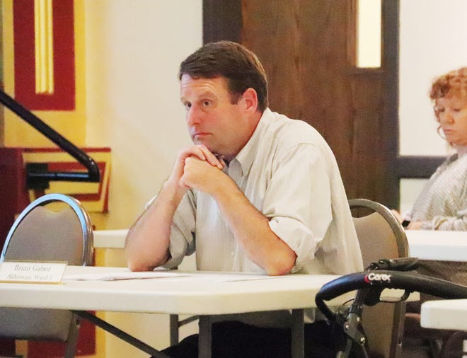 Alderman Brian Gabor listens during discussion of a variance request Monday night made by the Flanagan State Bank regarding placing a sign in its window at its 423B W. Madison St. location. The Pontiac City Council tabled the request.