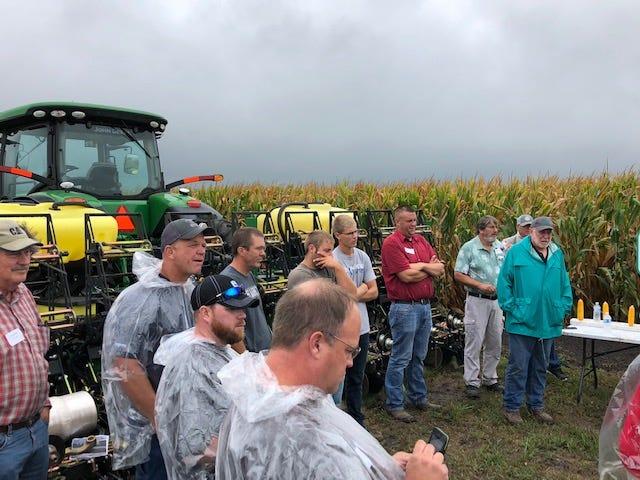 Farmers tour the Precision Planting PTI Research Farm at Pontiac during a previous season.