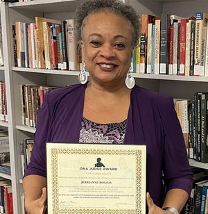 JerriAnne Boggis poses with her Ona Judge Award certificate.