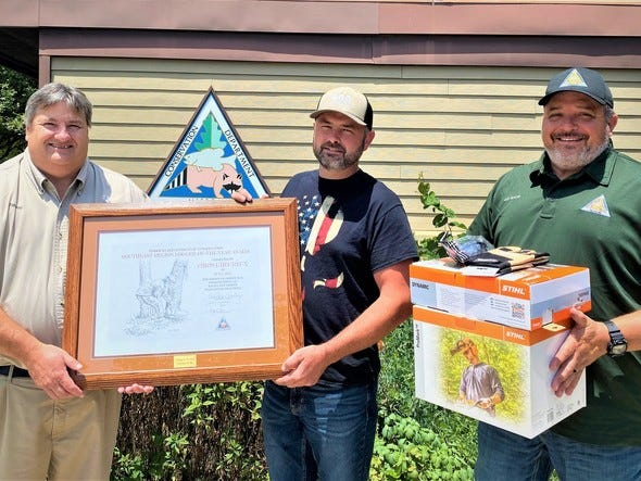 Missouri Department of Conservation Regional Administrator Tony Jaco and MDC Regional Resource Management Supervisor Matt Bowyer (right) are seen recognizing Chris L'Heureux of Wayne County (middle) as the Southeast Regional Logger of the Year. L'Heureux received a framed certificate, Stihl woodcutter's safety kit with chainsaw chaps, a saw helmet system, leather gloves, and safety glasses.