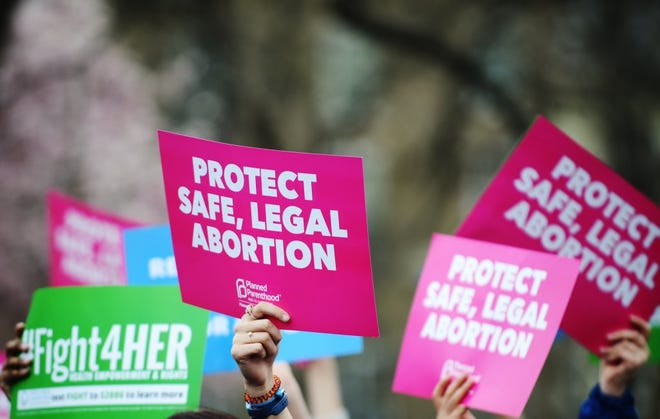 """People attend a """"Fight4Her"""" pro-choice rally in front of the White House at Lafayette Square on March 29, 2019 in Washington, DC. Photo by Astrid Riecken/Getty Images"""