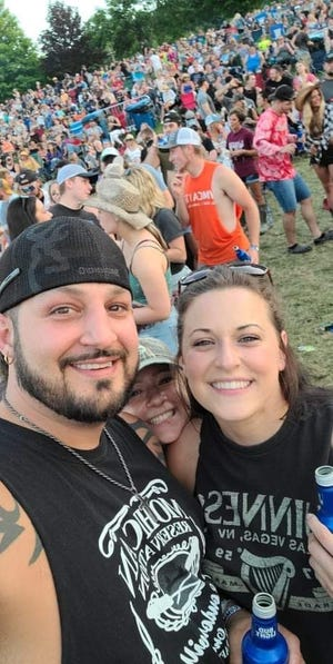 Brad Roberts, of Canton Township, and his fiancee, Franchesca Lyon, attended The Country Fest in June at Clay's Park Resort in Stark County. Roberts is also attending The Country Fest 2 this week at the same venue. For the first time, organizers are holding two Country Fests in one summer.