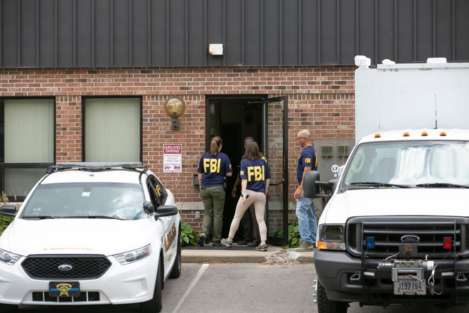 FBI agents raid the Housing Authority of South Bend offices on July 31, 2019. Federal prosecutors Tuesday announced charges against six individuals in the case, including former executive director Tonya Robinson.