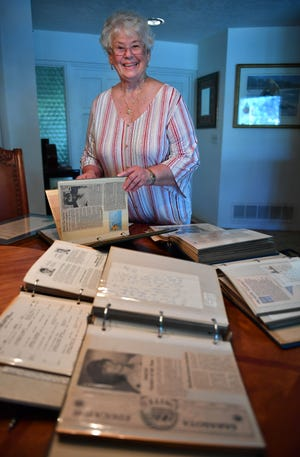 Edie Smith, an English teacher in Sarasota, was named Florida Teacher of the Year in 1984. She looks through scrapbooks filled with newspaper articles and congratulation notes from friends and students at her home in Sarasota.