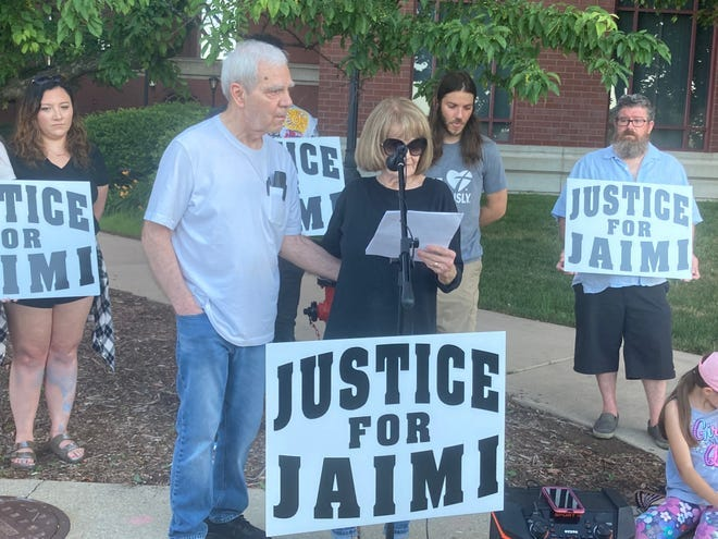 Jaimeson Cody's stepmother, Cindy Cody, speaks at a rally outside of the Sangamon County Jail in Springfield, Ill. on June 16. At left is Dan Cody, Jaimeson's father.