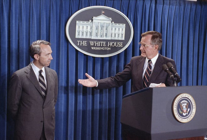 President George H. W. Bush, right, speaks to reporters at the White House as he announces his nomination of appellate Judge David Souter to a seat on the Supreme Court on July 23, 1990, Washington, D.C.