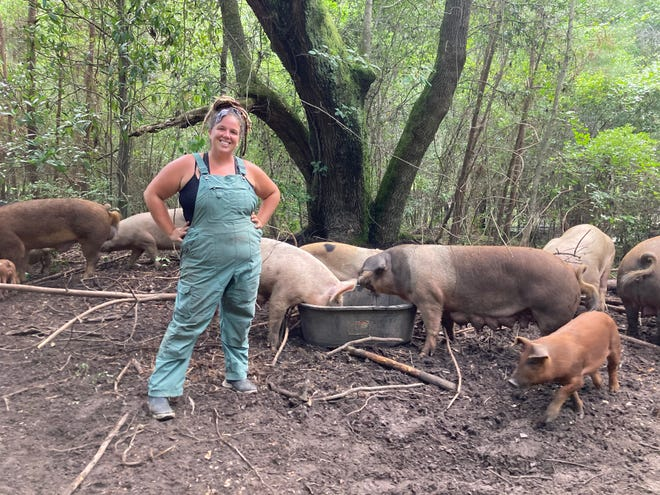 Farmer Marissa Paykos finished feeding the pigs on Whippoorwill Farms.