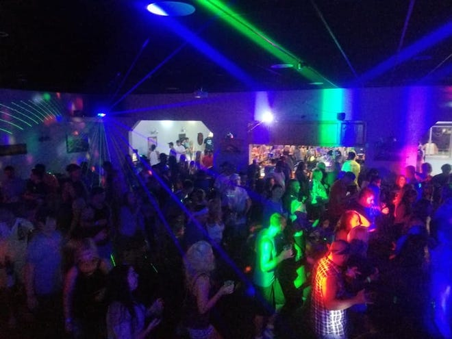 Clubgoers enjoy their time at the Tortuga's Nest in Surf City.