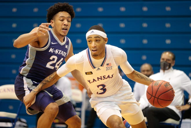 Kansas Jayhawks point guard Dajuan Harris, right, will play for the USA East Coast all-star Red team against international competition this August in Spain.