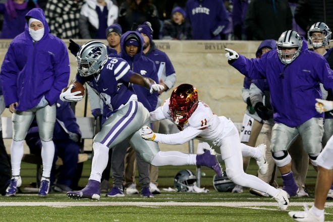 Kansas State running back Jacardia Wright, left, will look to make an impact on the rushing attack this year after falling down the depth chart behind freshman All-American Deuce Vaughn.