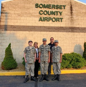 On July 6, three Somerset County youth were promoted in the Civil Air Patrol Cadet Program. Ayden Boyd, a ninth-grade student enrolled at the North Star school district, Austin Jones, a sixth-grade student enrolled at the Windber school district, and Kolten Lohn, an eighth-grade student enrolled at the North Star school district, were all promoted to the grade of cadet airman and presented with the General J. F. Curry Award. The award honors Gen. John F. Curry, the first national commander of the Civil Air Patrol, who in 1941 organized 100,000 private pilots from across the country into a volunteer force to supplement the War Department's efforts in guarding our nation. Presenting the awards were Somerset County Commissioner Pamela Tokar-Ickes and Southwest Group One Cmdr. Maj. Earl Gardner. The Somerset County Civil Air Patrol is currently seeking youth sixth through grade 12 for the cadet program. There are also several positions available for adults wishing to serve as well. Visit www.gocivilairpatrol.com for more information. From left to right: Jones, Tokar-Ickes, Boyd, Gardner and Lohr.