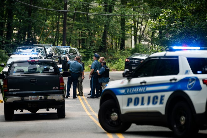 Investigators closed down an area of Granite Street on Tuesday. Gunshots had been reported on Cutler Street and a suspect fled the scene on foot after crashing his car into the woods.