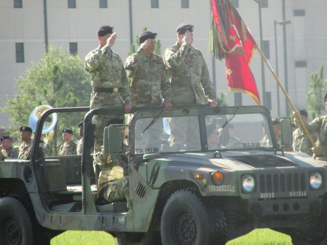Brig. Gen. David Stewart, Col. Chuck Matallana and Col. Marc Pelini salute troops during a review at a 108th Air Defense Artillery Brigade command change ceremony held Tuesday, July 20, 2021, at Fort Bragg.