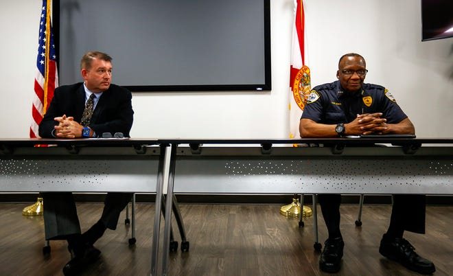 State Attorney Brian Kramer and Gainesville Police Chief Tony Jones sit at a table during a press conference Tuesday where they discussed recent shootings in Gainesville at the Eighth Circuit State Attorney's Office.