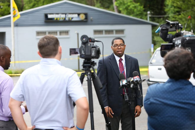 John Alexander, director of public affairs at the Gainesville Police Department, updates members of the media about the shooting of five teens at American Legion Post 16 in Gainesville on June 25.