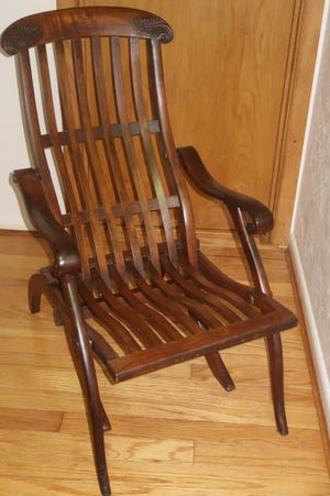 Based on this folding deck chair's looks and hardware, it does not appear to have been used on a cruise ship.