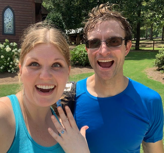 """Abigail Lundquist and Joshua Mather posed for this selfie at Noccalula Falls after Mather proposed underneath the falls July 10. Brandi Smith captured their proposal and posted photos on her Facebook page """"A Perfect Occasion,"""" and waterfall sites to find the couple and share her photos."""