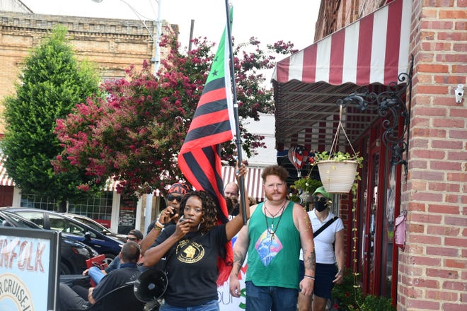 (FILE) Faith Cook leads demonstrators in one of two marches around Graham's Court Square during a June 2021 protest. HB805 opponents fear similar demonstrations could be targeted if the bill becomes law.
