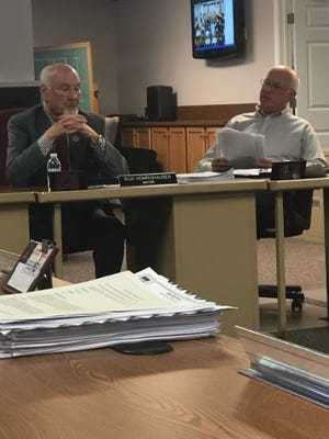 Dover Law Director Doug O'Meara (right) questions Mayor Richard Homrighausen during a meeting of Dover city council on Monday.