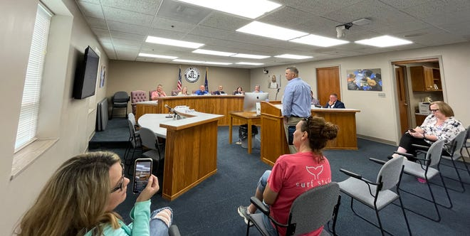 Bryce Bennett answers questions before the North Lawrence Community School Board Monday evening at an open interview session to fill a vacant seat on the board.