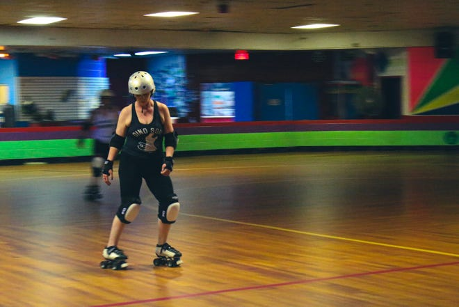 A member of the River Valley Roller Derby warms up at practice on July 19. The team meets at 7 p.m. on Mondays at Wheels in Motion in Van Buren.