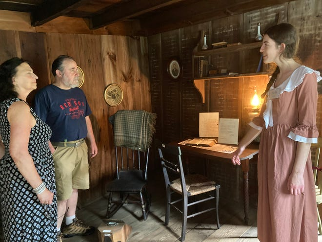 Stella Scire , right, gives Jim and Carol Unger a tour of the Fisher Richardson House in Mansfield.