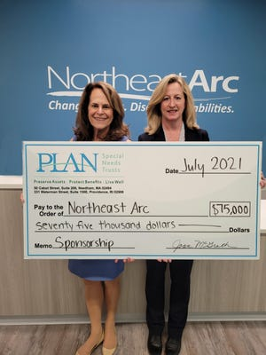 From left: Jo Ann Simons, president and CEO of Northeast Arc, accepts check from Joan McGrath, executive director of PLAN of MA & RI.