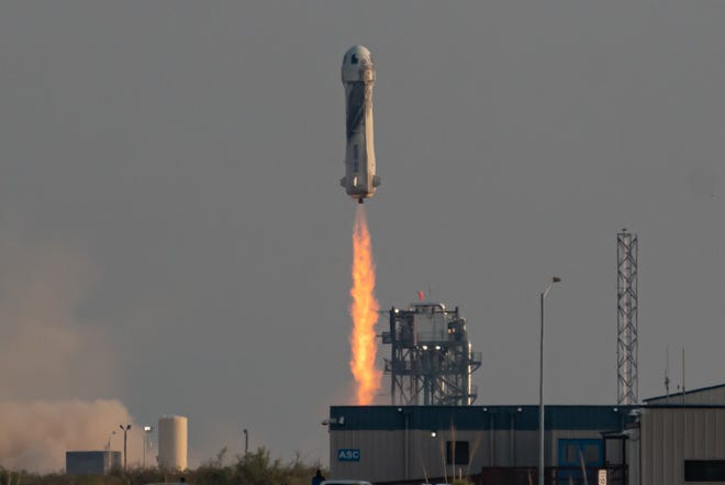 A Blue Origin New Shepard rocket and capsule launch from Texas on Tuesday, July 20, 2021 on the company's first crewed flight. The mission included Jeff Bezos, his brother Mark Bezos, aviator Wally Funk, and student Oliver Daemen.