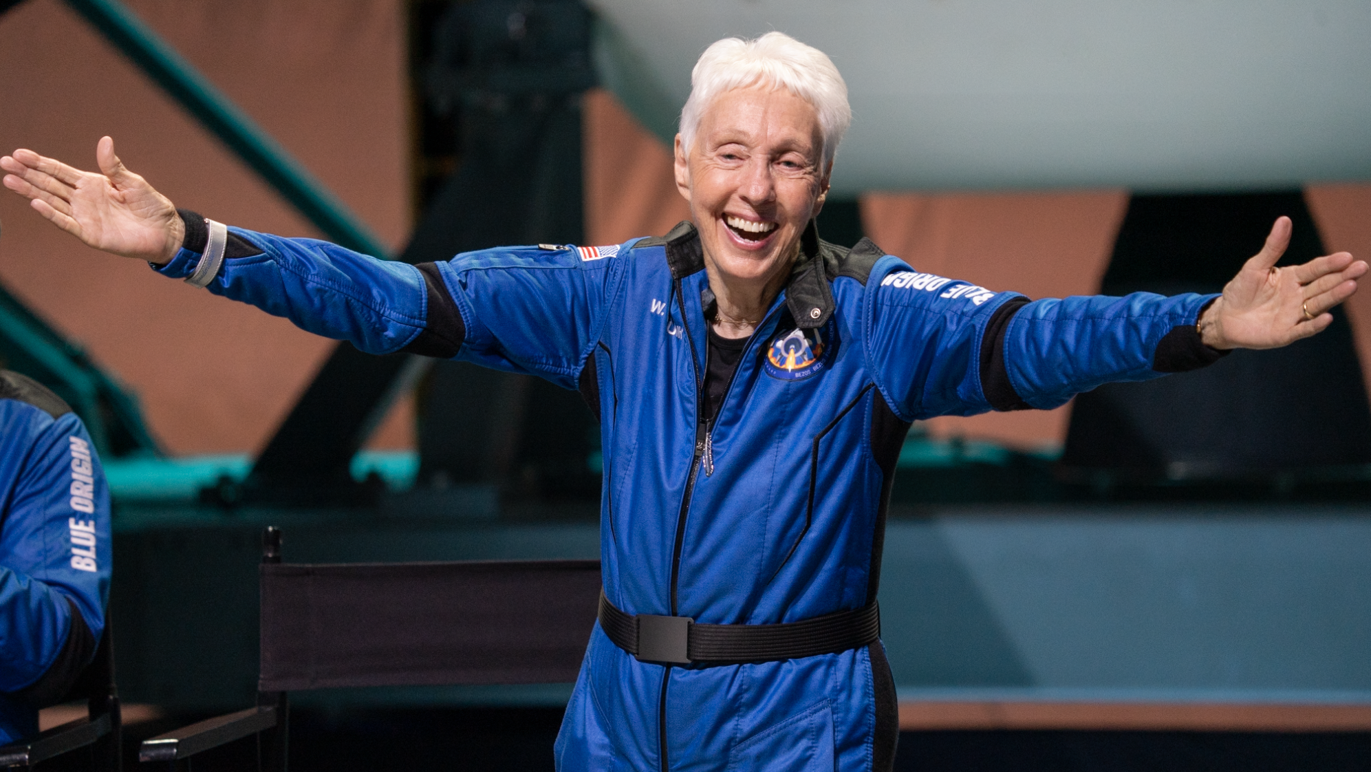 Wally Funk, 82, celebrates after her successful flight on New Shepard on Tuesday, July 20, 2021. She is officially the oldest person to have traveled to space.