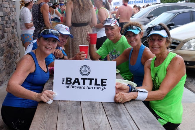 """Participants show their pride for their favorite Brevard town during a past """"Battle of Brevard"""" fun run/walk. The next """"Battle"""" will happen Aug. 4."""