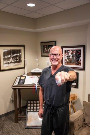 Reds medical director Dr. Tim Kremchek has performed around 2,500 Tommy John procedures