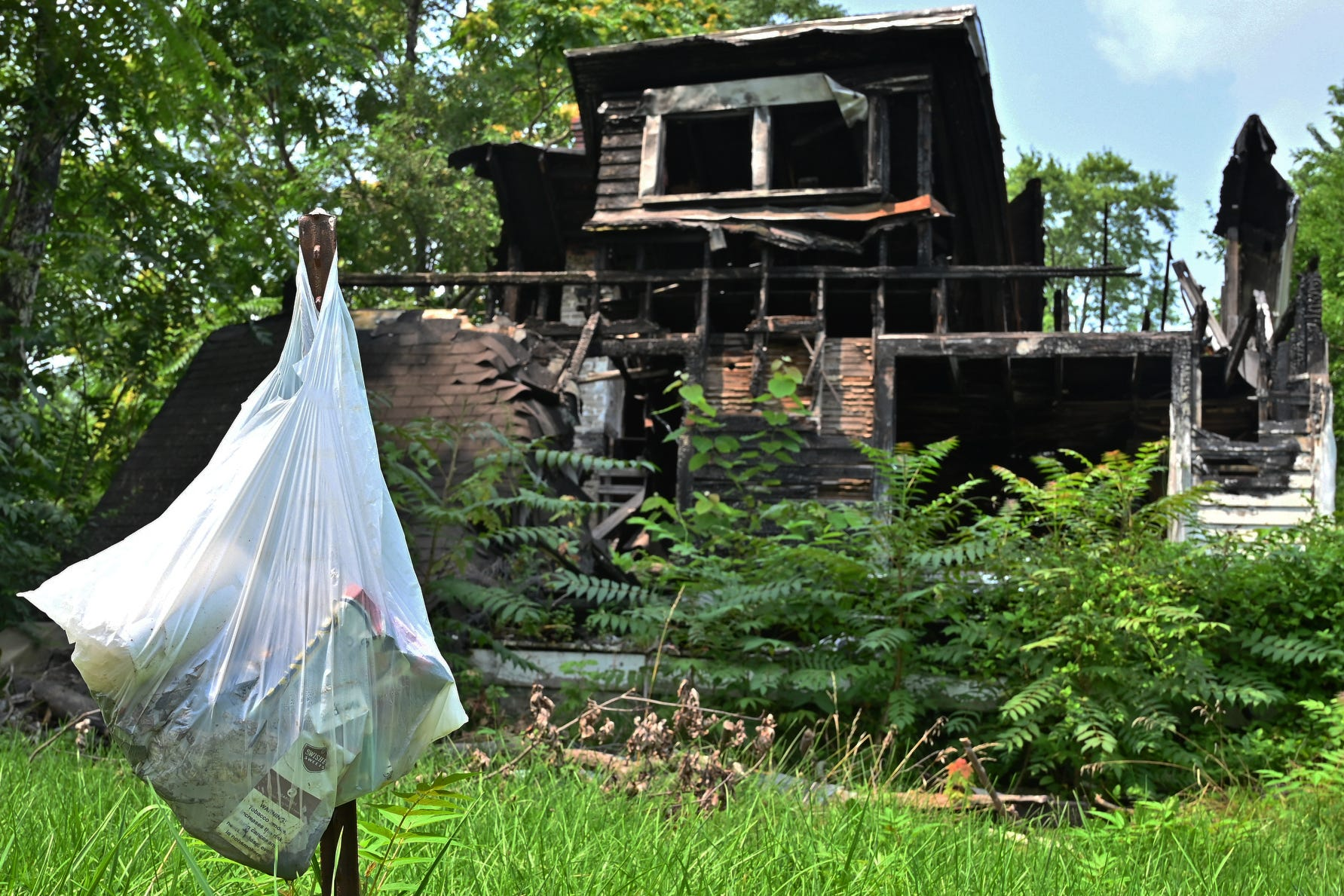 A home which has been vacant for over two years, according to neighbors, occupies space along Crown Avenue in Dayton, Ohio on Tuesday, July 20, 2021. The local government in Dayton, Ohio wants to demolish abandoned homes with money gained from the American Rescue Plan, and wonders if the federal government will allow their procedures.