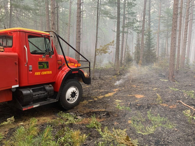 A wildfire burned about 6 acres of Pictured Rocks National Lakeshore and adjacent state forest in Michigan's Upper Peninsula July 19, 2021, authorities said.
