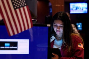 Trader Ashley Lara works on the floor of the New York Stock Exchange, Tuesday.