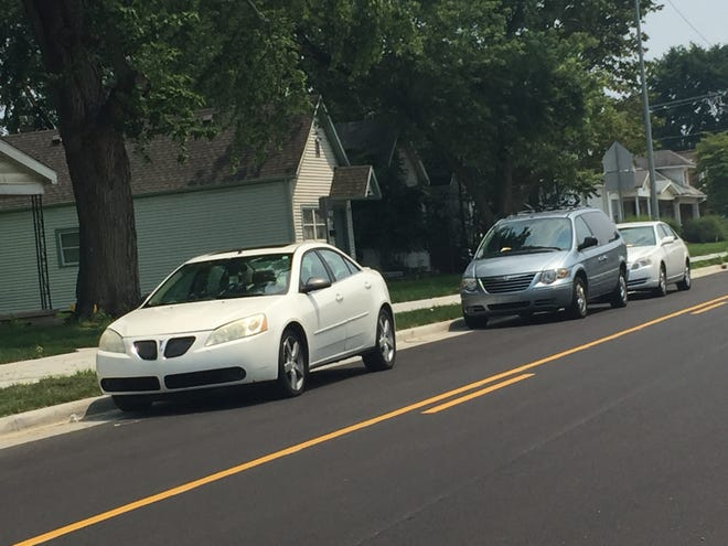 """These three vehicles were among several parked Tuesday in the westbound lane of newly reopened Walnut Street, near U.S. 41. Evansville city officials said such parking isn't allowed, and """"no parking signs"""" have been ordered."""