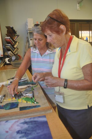 Carole Brokke and Dawn Wacenske work on a stained glass creation. Pelican Preserve has much more than tennis, golf and fitness rooms. It has places for all kinds of activities. Both ladies say it was the craft rooms that attracted them to the community in Fort Myers.