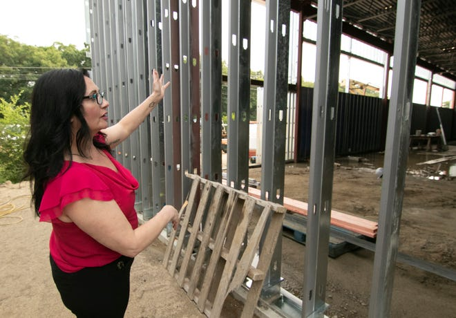 Brighton Market manager Tracy Doell talks on Tuesday, July 20, 2021 about the new building for the Green Oak Township store.