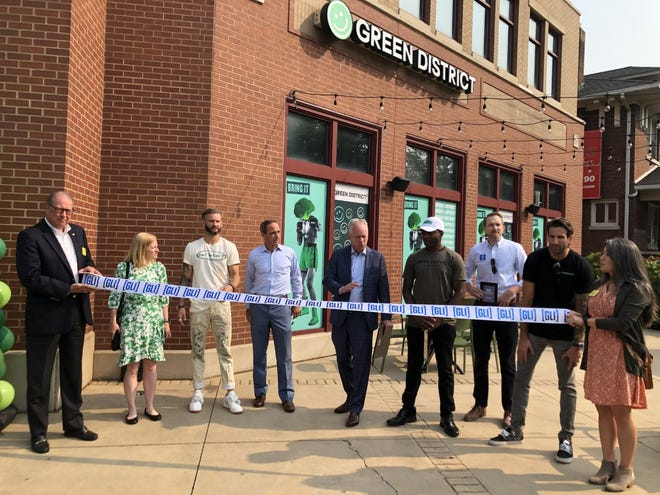 Louisville officials and Green District leaders hold a ribbon cutting ceremony to open the new restaurant at 449 Bardstown Road on Tuesday, July 20.